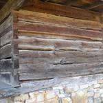 Here's a close-up view of the back, second story. Notice the big gap between the third and fourth logs. Also notice the little door and the porch that's just laying there.